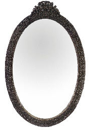 AN INDIAN HARDWOOD OVAL MIRROR