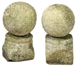 A PAIR OF CARVED GRIT STONE OR