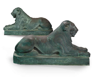 A PAIR OF LARGE BRONZE RECUMBE