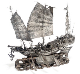 A silver model of a Chinese wa