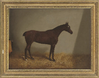 A bay hunter in a stable; and