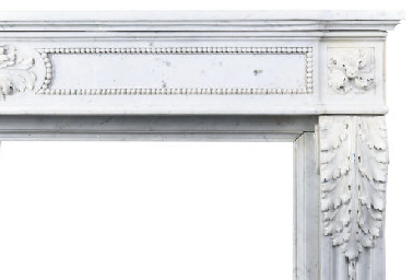 A CARVED MARBLE CHIMNEYPIECE
