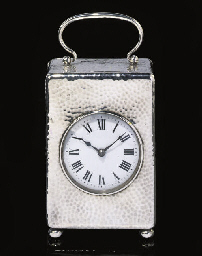 AN ENGLISH SILVER DESK TIMEPIE