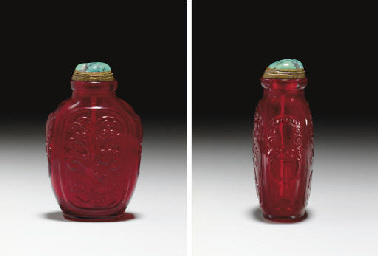 **AN UNUSUAL CARVED RED GLASS