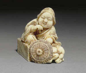 An Ivory Netsuke and Two Wood