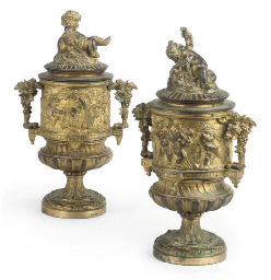 A PAIR OF GILT BRONZE URNS