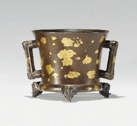 A GOLD-SPLASHED BRONZE TRIPOD