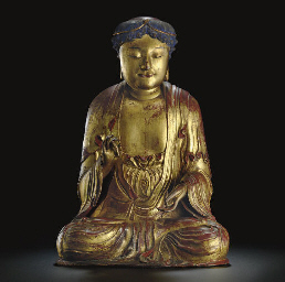 A GILT-WOOD FIGURE OF THE SEAT