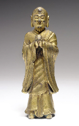 A GILT-BRONZE FIGURE OF A STAN