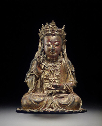 A GILT-LACQUERED BRONZE FIGURE