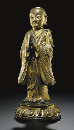A GILT-BRONZE FIGURE OF A LUOH