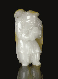 AN UNUSUAL WHITE JADE FIGURE O