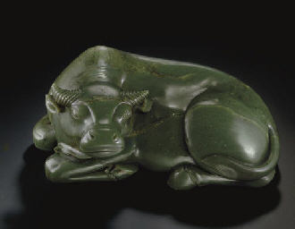 A RARE LARGE DARK GREEN JADE FIGURE OF A WATER BUFFALO