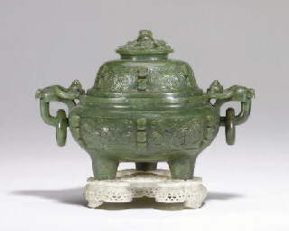 A WELL-CARVED GREEN JADE TRIPO