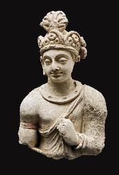 A stucco bust of a Bodhisattva