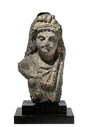 A gray schist bust of Maitreya