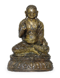 A bronze figure of a lama