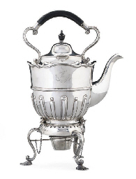 A LATE VICTORIAN SILVER TEA KE