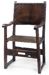 A SPANISH WALNUT ARMCHAIR