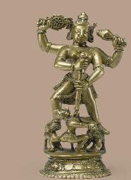 A brass figure of Durga slayin