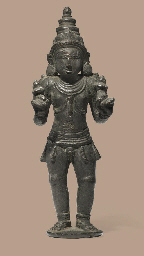 A bronze figure of a Skanda