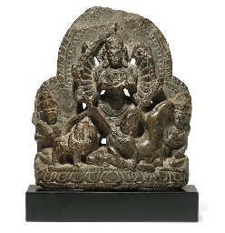 A gray stone figure of Durga