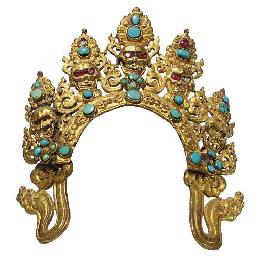 A gilt copper repousse crown o