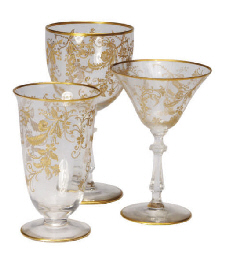 AN ITALIAN GILT PART STEMWARE