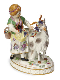 A GERMAN PORCELAIN GROUP OF A