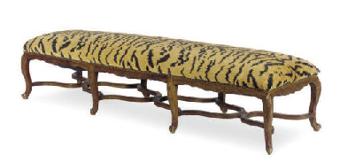 A WALNUT AND UPHOLSTERED BENCH