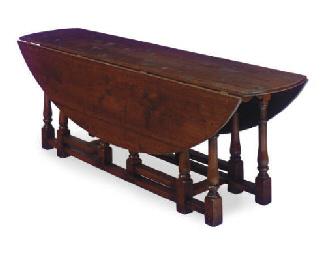 AN OAK GATE-LEG DINING TABLE,