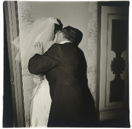 Groom kissing his bride, N.Y.C