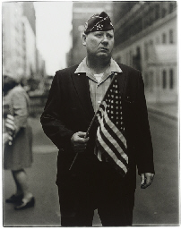 Veteran with a flag, N.Y.C. 19