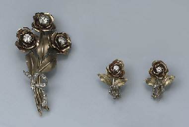 A DIAMOND FLOWER BROOCH AND TW