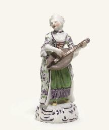 A LIMBACH FIGURE OF A MUSICIAN