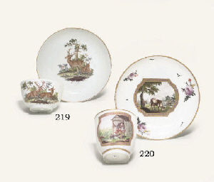 A GERMAN PORCELAIN TEACUP AND