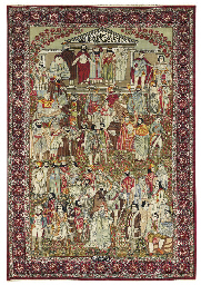 A PICTORIAL KIRMAN CARPET