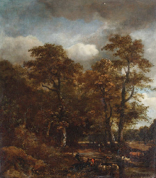 A wooded landscape with cattle