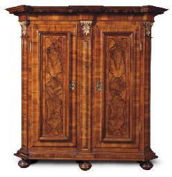 AN AUSTRIAN PARCEL-GILT WALNUT
