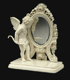 A FRENCH IVORY FIGURE OF A CUPID AT A MIRROR**