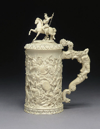 A GERMAN CARVED IVORY TANKARD*