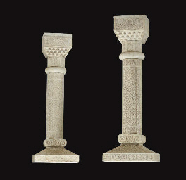 A PAIR OF CARVED MARBLE PEDEST