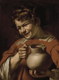 Young boy holding a pitcher