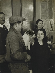 Couple with a dog in a café, c