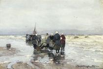 Fisher women waiting on the beach