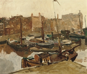 Damrak: Moored boats on the Da