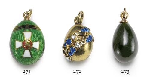 A Jeweled Gold Miniature Egg P