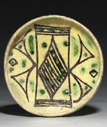 A RAQQA GLAZED POTTERY SHALLOW