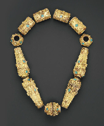 A SELJUK TURQUOISE INSET GOLD