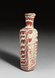 A MAMLUK MARVERED OPAQUE RED A